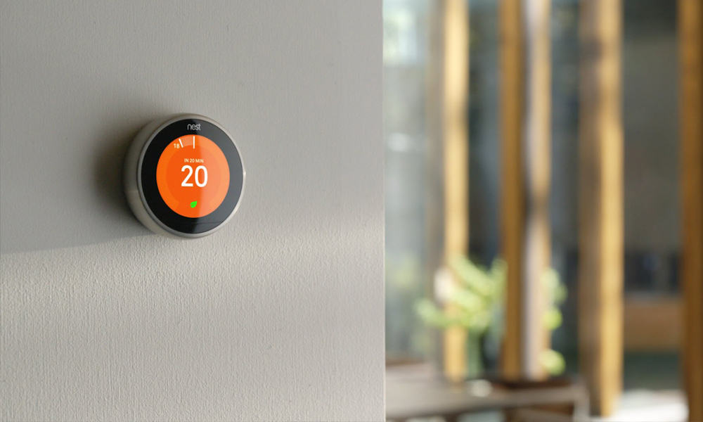 Intelligent thermostat on the wall controlling the air conditioning